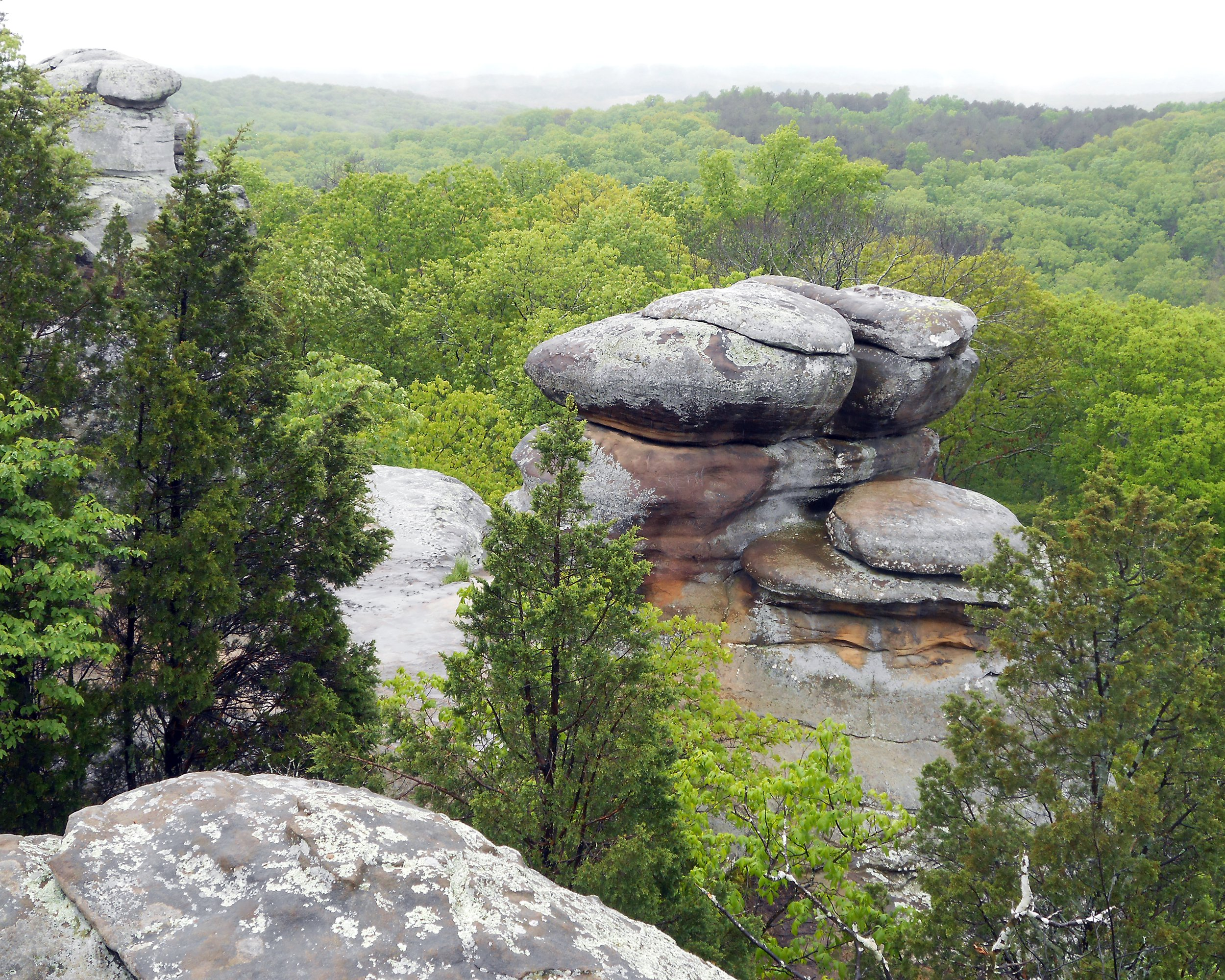 Slide 14 of 52:  Where: Shawnee National Forest Distance: 3-mile loop Must see: This canyon descent features beautifully carved sandstone rock, waterfalls and rivers.