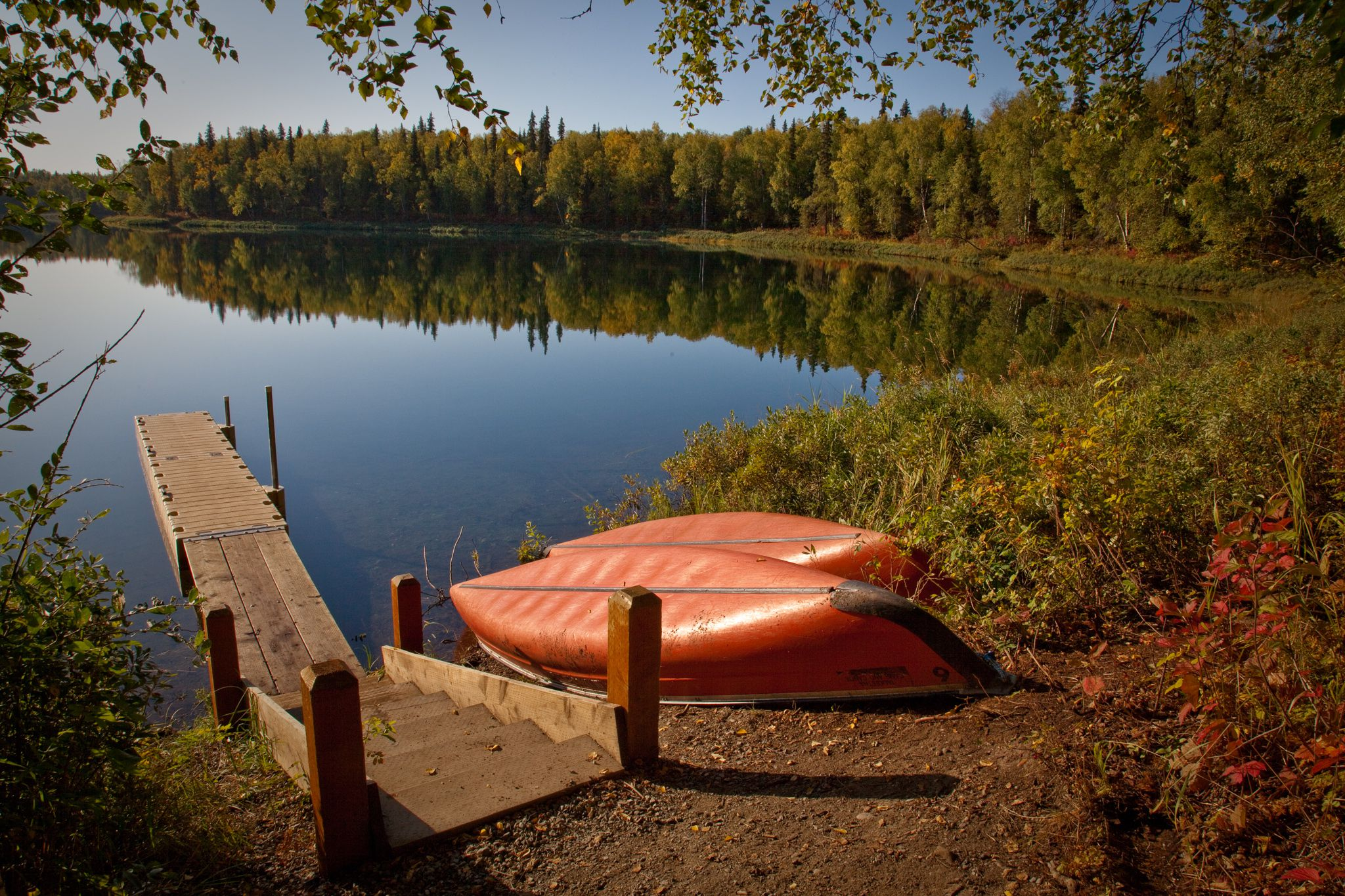 Slide 3 of 52:  Where: Talkeetna Lakes Park Distance: 3.5-mile loop Must see: In the fall, this is the prime spot to go blueberry-picking. This trail circles X Lake and takes you through beautiful old-growth forests where you're bound to see wildlife and can enjoy fishing.