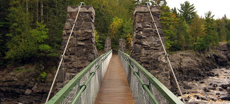 Slide 24 of 52:  Where: Jay Cooke State Park Distance: 3.5-mile loop Must see: Get excited to cross the Swinging Bridge, which hangs above the St. Louis River and offers views of the Silver Creek.