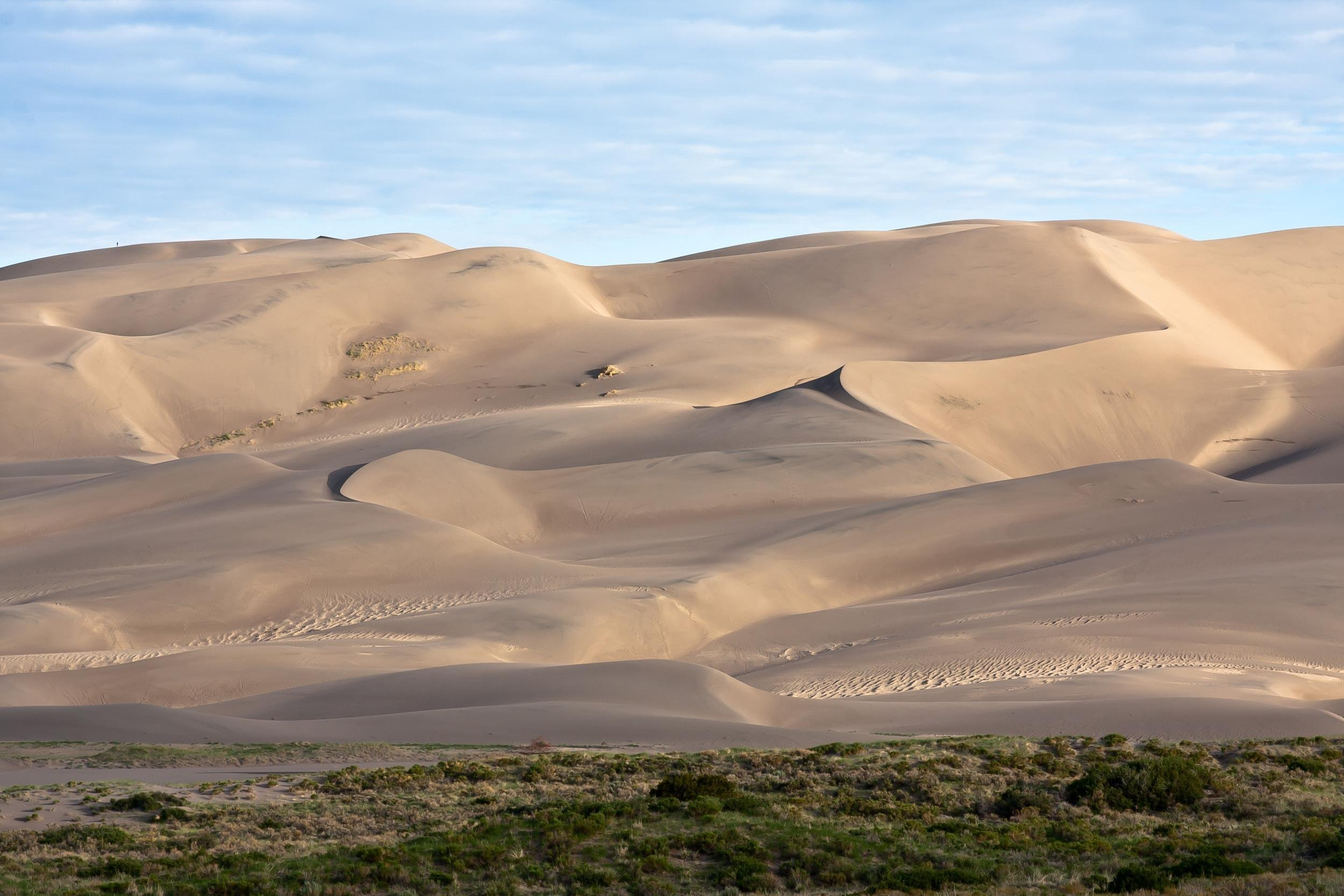 Slide 7 of 52:  Where: Great Sand Dunes National Park Distance: 1 mile out and back Must see: You can get up close and personal with a majestic waterfall and enjoy breathtaking views of the dunes on this short trail, which includes wading into a rock crevasse.