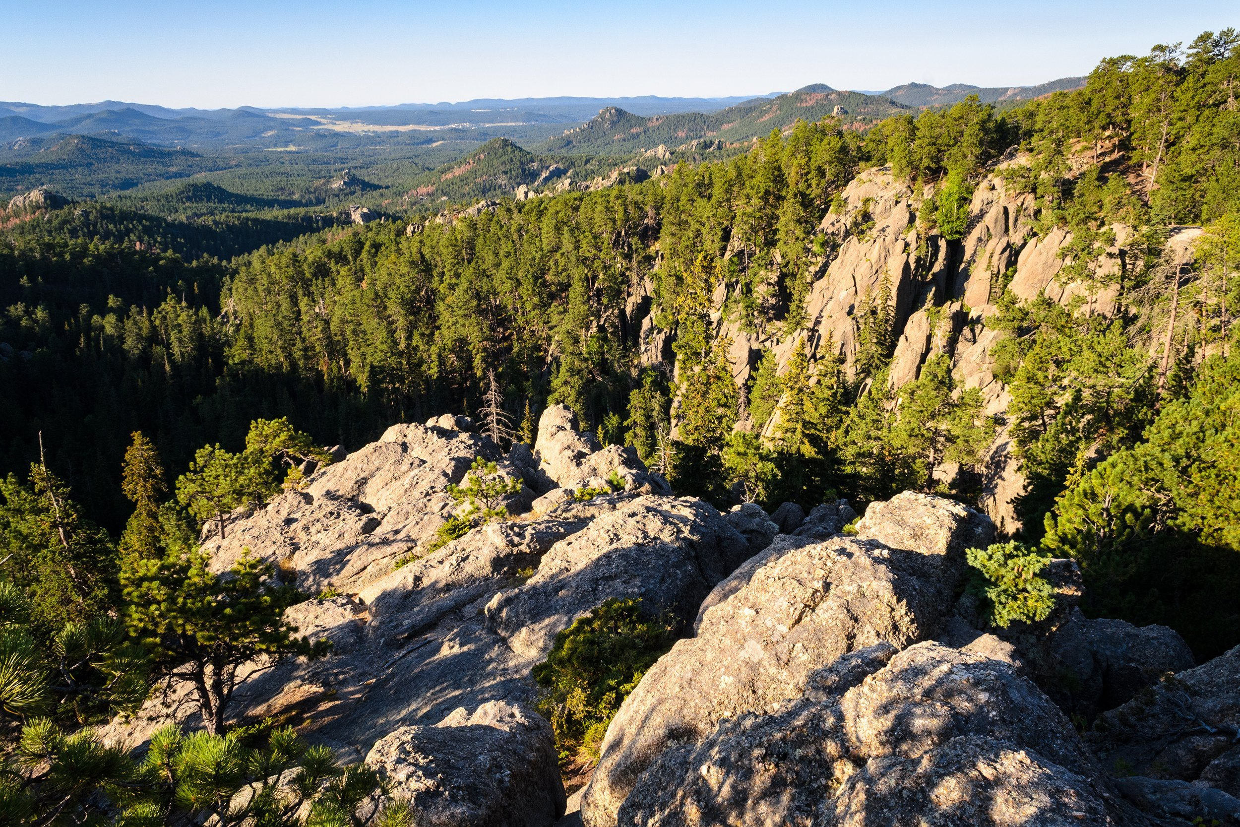 Slide 42 of 52:  Where: Black Hills National Forest Distance: 5.9 miles out and back Must see: Look out for wild turkeys and deer along the way on your way up the peak. Once you've reached the peak, you'll get panoramic views of Black Hills Mountains, including Terry Peak and Bear Butte.