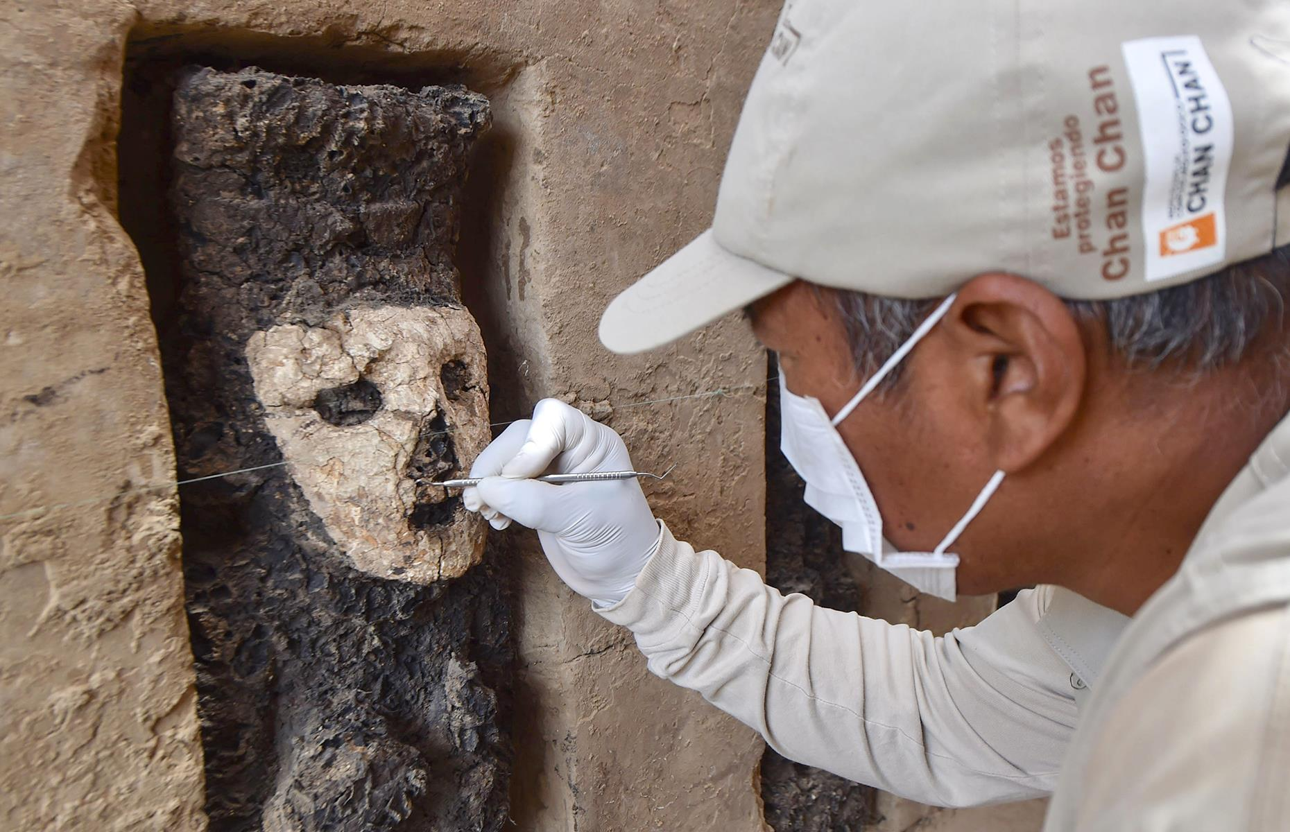 "Slide 8 of 50: An intricate adobe wall and some 19 wooden statues were discovered on the site at the end of 2018. It's thought that the structures were buried around 750 years ago and each one stands around 26 inches (70cm) tall, cast in wood, with a simple clay mask. The figures also seem to wield both a scepter and a shield. Experts believe the statues could have served as ""guardians"" and excavation work is set to continue."