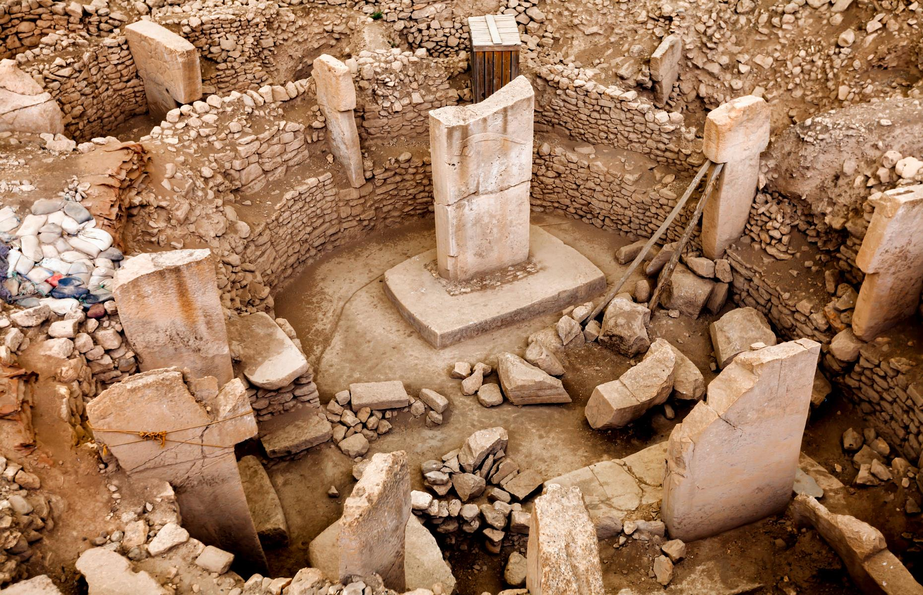 Slide 32 of 50: Widely touted as having the world's oldest temple, the site of Göbekli Tepe in Turkey has its origins between 9,600 and 8,200 BC, dramatically predating better-known wonders, such as the revered Pyramids of Giza. The plot is made up of limestone megaliths and is said to have never been inhabited. Instead, experts believe Göbekli Tepe had a ceremonial or funereal purpose, and ancient peoples would come here to worship. Since the site was originally written off as a graveyard in the 1960s, real excavation work only began in the early 1990s. This means there's still much to be uncovered.