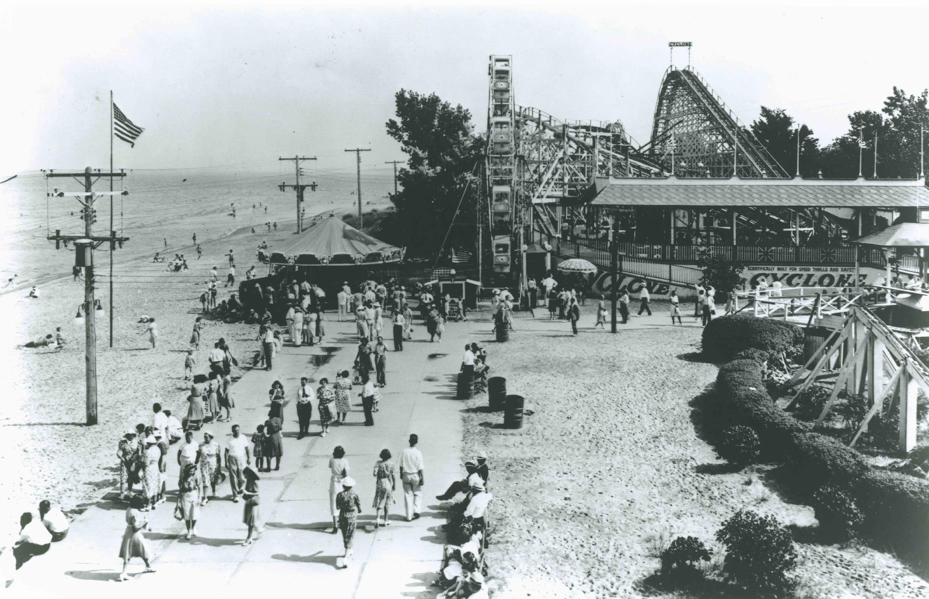 Slide 39 of 47: This theme park, one of the oldest in America, has always set great store by its thrill rides. The first roller coaster debuted here in 1892, a couple of decades after the park's inauguration, and this later shot shows the 1920s wooden Cyclone in the background. Cedar Point is known for its dizzying coasters today too.See more historic images of America's theme parks in full swing.