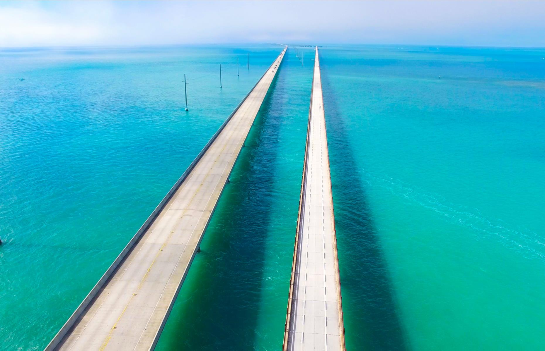 Slide 11 of 52: Jutting into an expanse of brilliant blue, this concrete bridge seems to stretch for hundreds of miles. But, as the name suggests, it continues for just under seven, joining up the idyllic Florida Keys. The landmark is actually two separate bridges. The older of the two, completed in 1912, is closed for lengthy repairs until 2021.