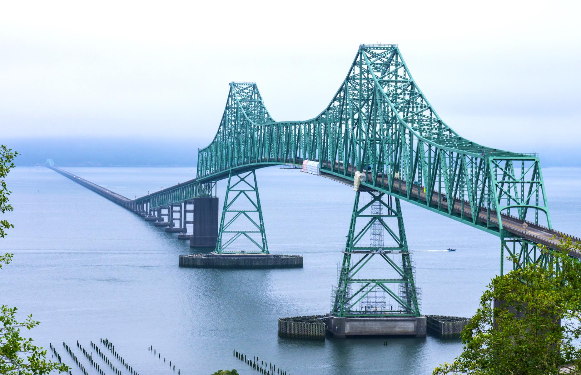 Slide 39 of 52: The longest truss bridge in the States, the Astoria-Megler was dedicated in 1966. It spans the Columbia River, connecting the states of Washington and Oregon, and upon its completion, it also became the final link in the highway system connecting Mexico to Canada. Special events marked its 50th birthday back in 2016, including a dedicated exhibition at the Columbia Pacific Heritage Museum.