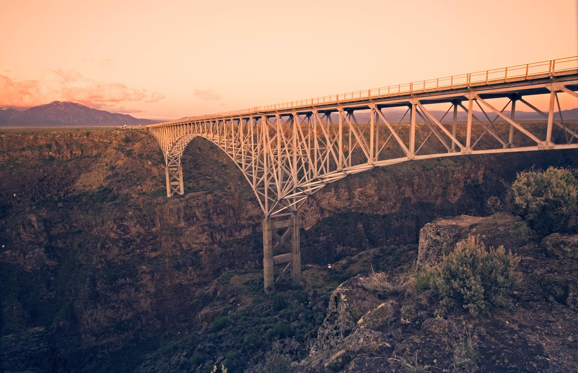 "Slide 33 of 52: This New Mexico structure is also known as ""High Bridge"" – and for good reason. A stone's throw from the ancient pueblos of Taos, this bridge spans the rugged Rio Grande Gorge, rising to a lofty 565 feet (172m). It's reached by Highway 64 and its movie-star good looks have earned it appearances in several films, most notably 1994 thriller Natural Born Killers."