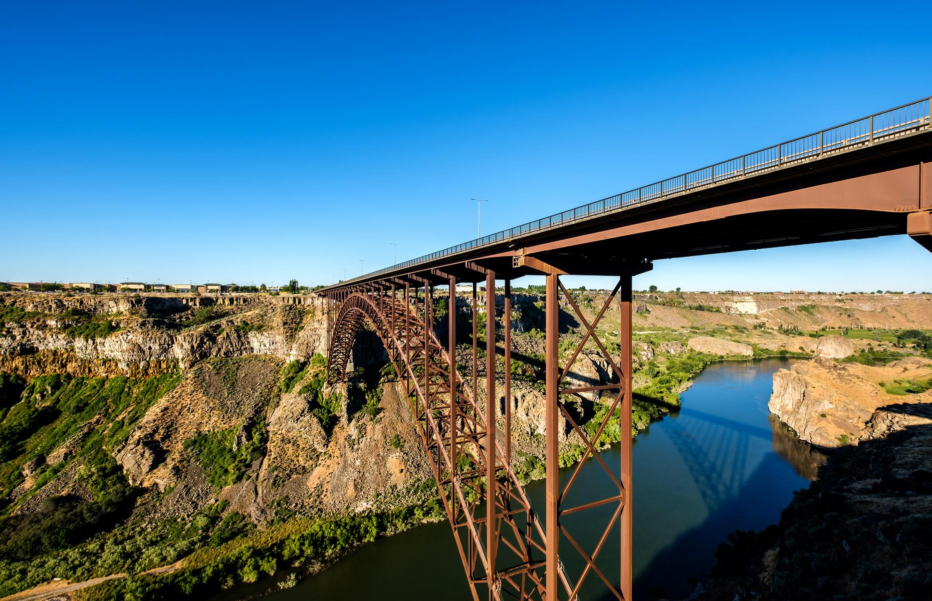 Slide 14 of 52: This simple but attractive truss bridge stretches over the Snake River, close to Twin Falls. It's almost 1,500-feet (457m) long and bookended by rugged canyon. The rust-red structure is impressive whichever way you look at it.