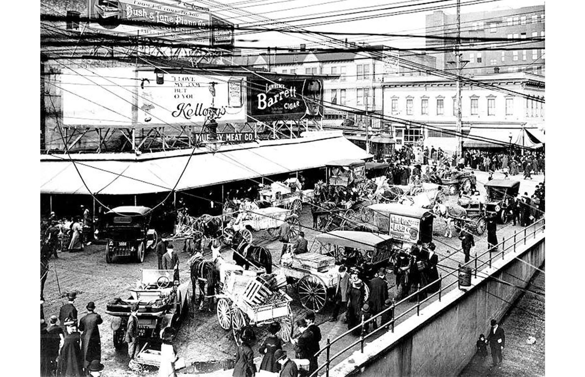 Slide 35 of 47: Seattle's Pike Place Market has been loved by locals and tourists alike since it opened back in 1907. It was originally built as the burgeoning city of Seattle demanded more fresh produce from local farmers – on the opening day, in August 1907, farmers brought wagons brimming with fruit and veg to the marketplace, and they quickly sold out. This photo shows wagons parked up outside the market around 1910.