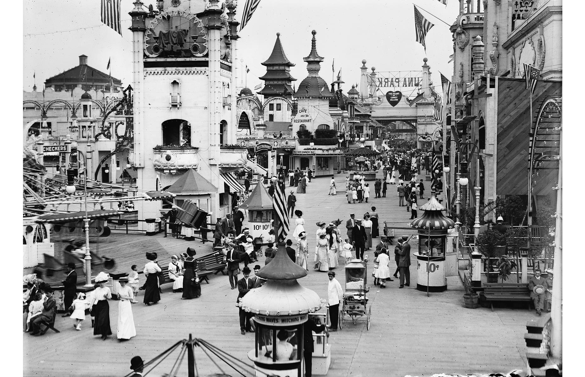Slide 24 of 47: The attraction-filled Luna Park (pictured) packed in visitors for a little over four decades, but was sadly gutted by a fire in 1944. Original Luna Park was known for its whimsical entryway, its Electric Tower, which lit up after dark, and wholesome attractions such as the Helter Skelter. It has now been reborn as a new Coney Island park, modeled on the original, which is pictured here in the early 1900s.