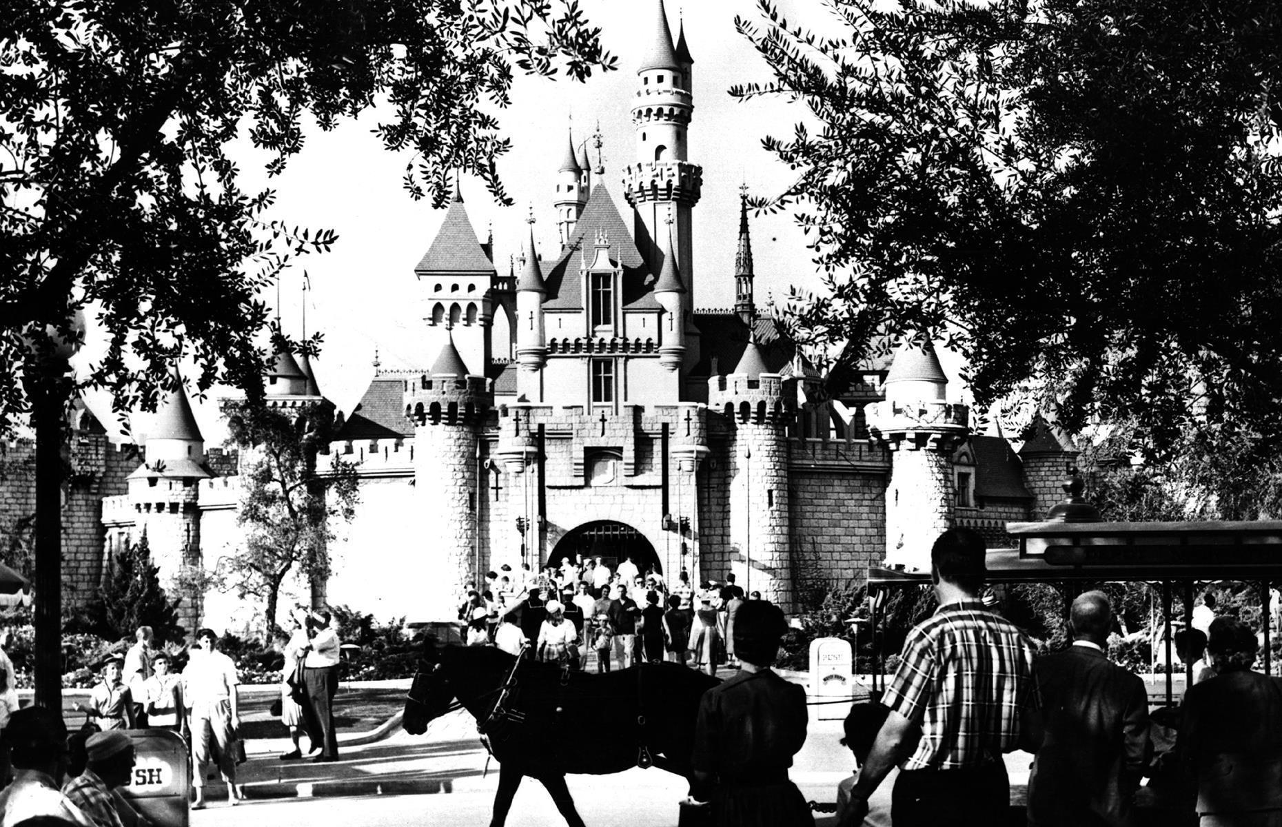 Slide 13 of 47: The park opened in 1955 to much applause, with the fairy-tale Sleeping Beauty Castle the star attraction. The opening day didn't go quite as planned, though, since hundreds more visitors than expected poured through the park gates. But luckily that didn't dim Disneyland's appeal – themed areas such as Fantasyland and futuristic Tomorrowland offered plenty for awe-struck early visitors to explore.