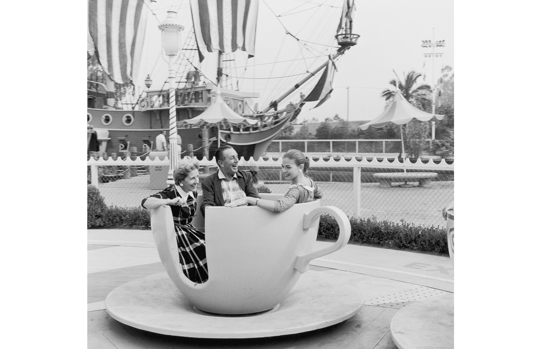 Slide 14 of 47: It wasn't unusual to spot Walt Disney himself in his beloved park in the early days, riding the attractions with his family, and chatting to visitors. Disney passed way in 1966, but he's pictured here in the 1950s, enjoying a whirl on the park's teacup ride with his wife Lillian and daughter Diane.
