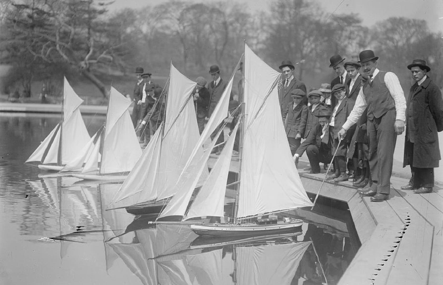 Slide 18 of 47: There's a long history of model yacht racing in Central Park too – in fact, the Central Park Model Yacht Club celebrated its 100th birthday back in 2016. The sport became particularly popular from the 1880s and remains so today –competitors are pictured here around 1910, getting ready to race their yachts on Conservatory Lake.