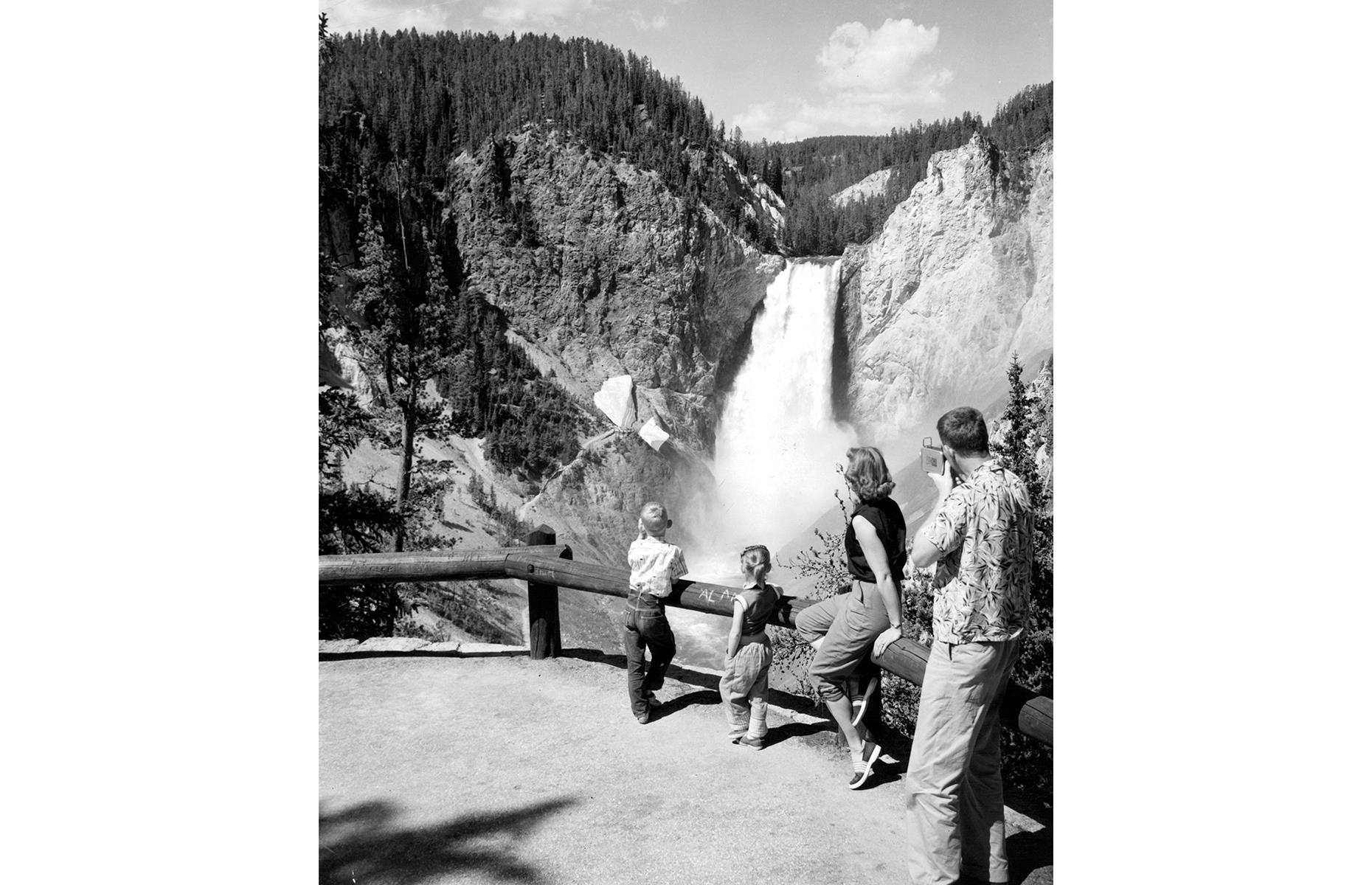 Slide 6 of 47: This national park is one of the largest in the USA too, leaving plenty of room for its revered natural wonders. Among them is Tower Falls, a 132-foot (40m) cascade in the northeast of Yellowstone, which you can take in from a scenic overlook. In this nostalgic shot, a young family admire the spectacle in 1955.