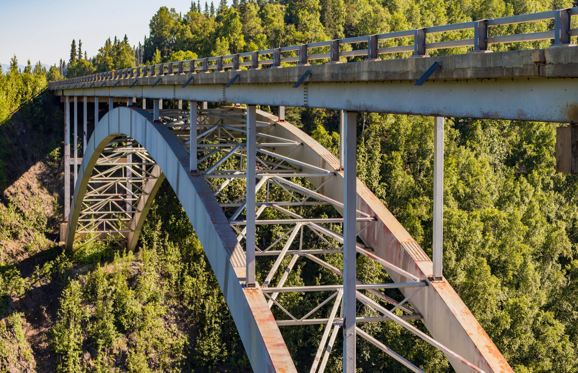 Slide 3 of 52: The hair-raising Hurricane Gulch Bridge rises some 296 feet (90m) above the Hurricane Creek in southern Alaska and spreads out for a whopping 918 feet (85m), making it the longest and tallest bridge on the Alaska Railroad. When it was erected in 1921, it was considered a true wonder of engineering and remains a head-turning sight today.