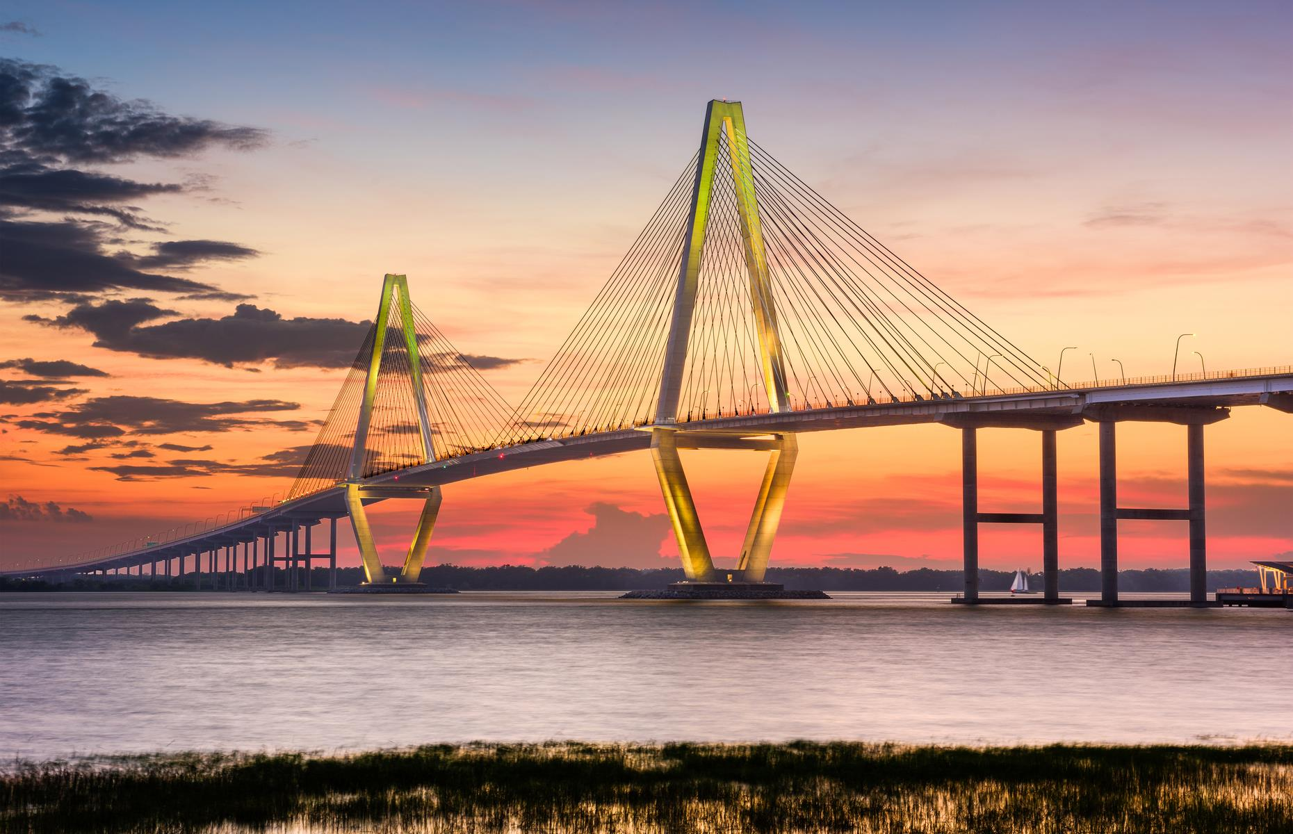 Slide 42 of 52: The twin spans of this dramatic cable-stayed bridge wows by day and night. A relatively new addition to the Charleston skyline, it was completed in 2005 and is named after the politician who led the project.