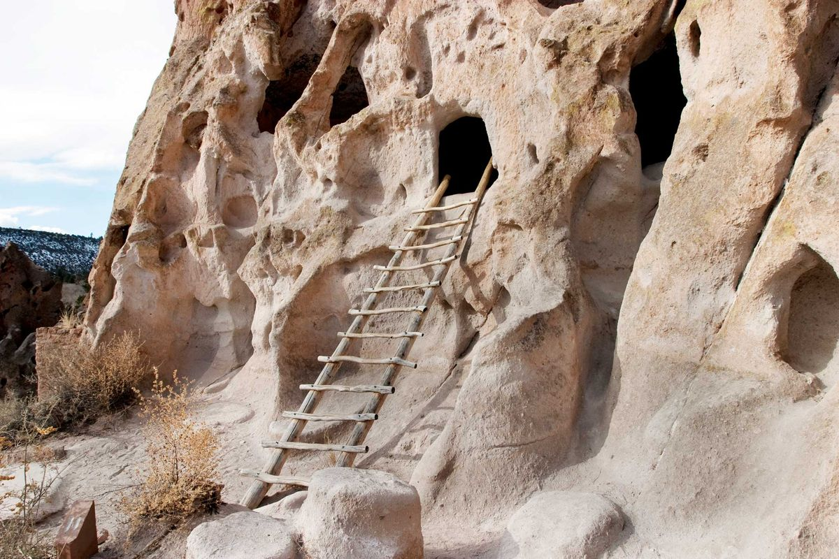 Slide 32 of 51: Bandelier National Monument Bandelier National Monument in Los Alamos, New Mexico, is one of the most underrated national sites to visit. Hikers can visit over 3,000 dwelling sites of the ancestral Pueblo people from over 11,000 years ago and can even climb ladders to go inside them.