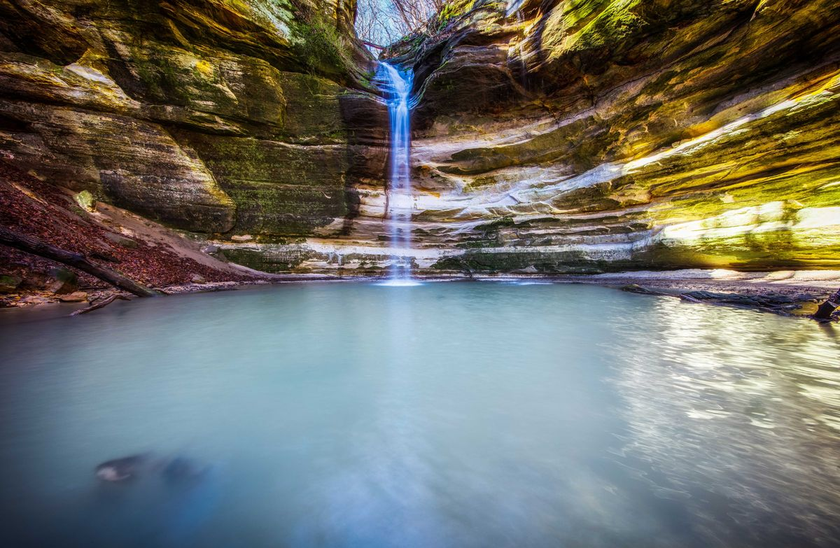 Slide 14 of 51: Starved Rock State ParkKnown for its sandstone canyons formed by glacial meltwater, Starved Rock State Park in Oglesby, Illinois, is a natural wonder. There's 13 miles of trails to explore with waterfalls, fishing, and boating.