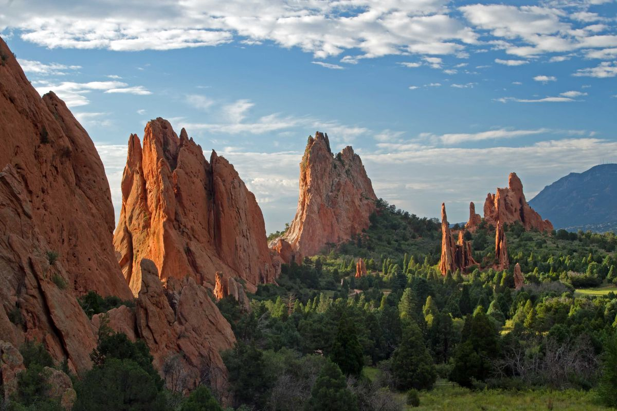 Slide 7 of 51: Garden of the Gods Explore what Colorado Springs has to offer in one magical place. Garden of the Gods is a registered National Natural Landmark, with dramatic views, 300 foot sandstone rock formations along a backdrop of mountainous views and blue skies.