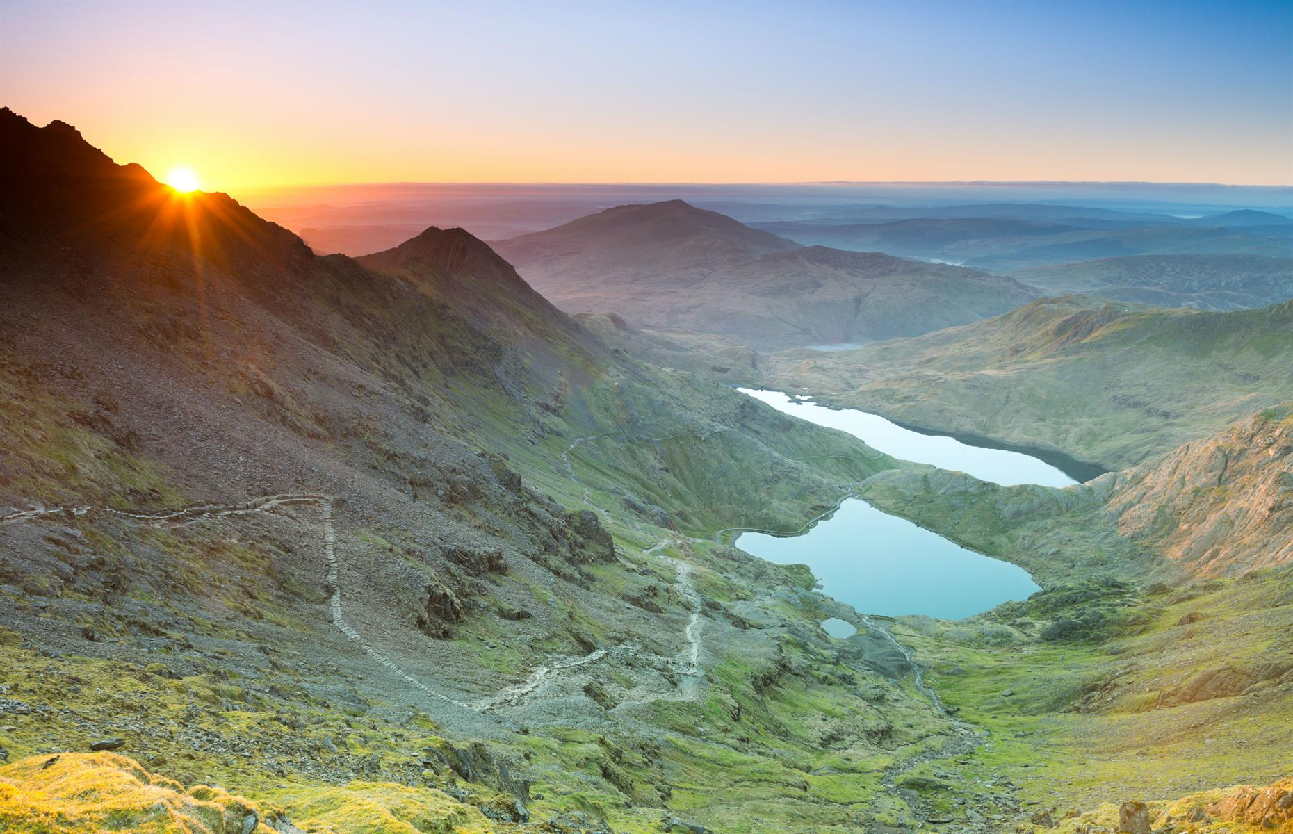 Slide 4 of 29: There are special hikes up Snowdon for those who want to catch the sunrise from the 3,560-foot (1,085m)peak of the tallest mountain in Wales. The five- to seven-hour trek isn't to be underestimated, but walking beneath a twinkling sky of stars, before being rewarded with the break of dawn over north Wales is certainly worth it. It's just one of the many reasons why we love Wales.