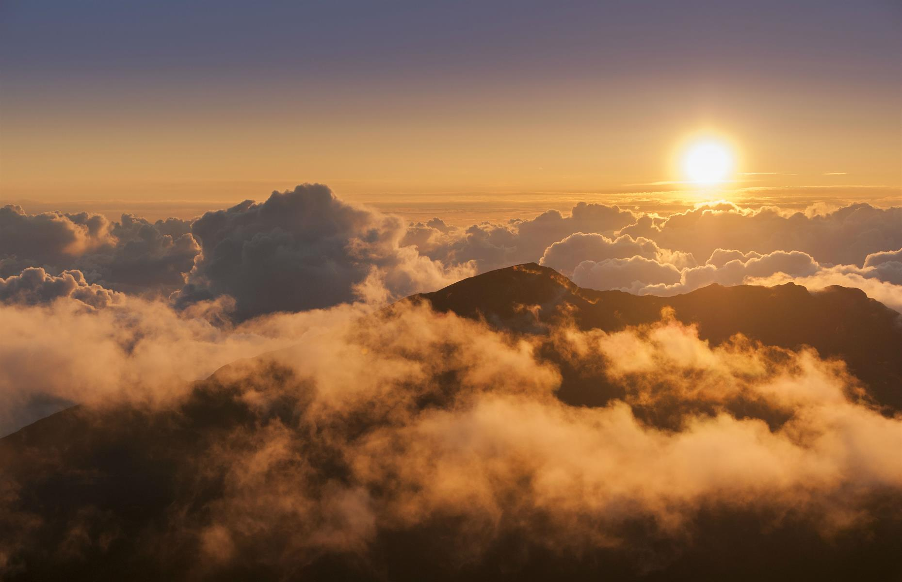 Slide 25 of 29: For perhaps the most beautiful sunrise in Hawaii, leave no later than 3.30am from Kahului to get to the peak of the wide volcano of Haleakala. You can drive up the Haleakala Highway and once you're there, 10,000 feet (3,055m) above sea level, it's just a matter of waiting for the world to turn different shades of red, giving way to an incredible volcanic landscape. Make a reservation to park your car seven days in advanceand bring plenty of warm clothing to fend off the early morning chill. The park is operating on a phased reopening basis so check the website before traveling too.
