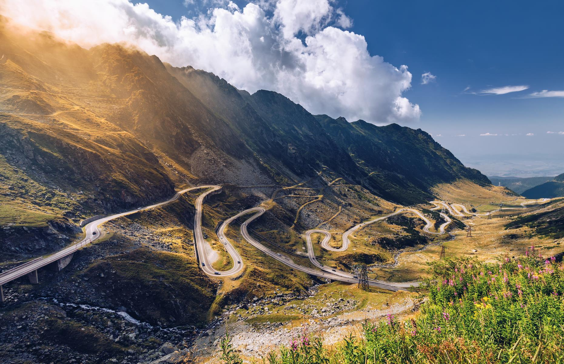 Slide 2 of 44: This beauty of a road is one of Europe's most majestic mountain routes. The Transfagarasan begins in Cartisoara and ends in Curtea de Arges across Romania's beautiful Fagaras Mountains, also known as the Transylvanian Alps. It was built for military purposes in the 1970s to connect the provinces of Transylvania and Wallachia. Its 6,699 feet (2,041m) at its highest point and has a seemingly endless series of bends, tunnels and viaducts to keep drivers alert.