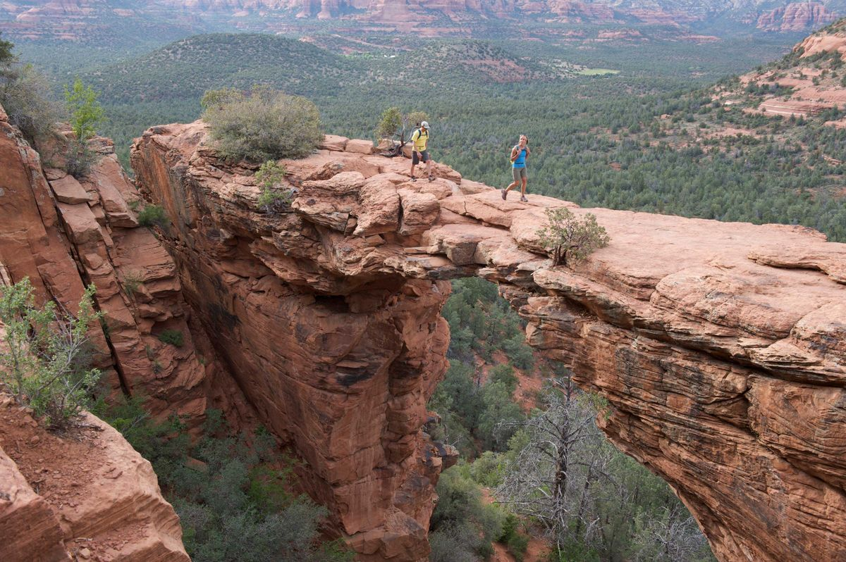 Slide 4 of 51: Devil's BridgeAside from local art shops and neutral architecture that blends in with the red rock landscape, Sedona is home to Devil's Bridge. With a natural bridge formation on this trail, it's no wonder why it's on the top of most hikers' lists. It does get crowded so be sure to get there early if you don't want anyone in your photo.