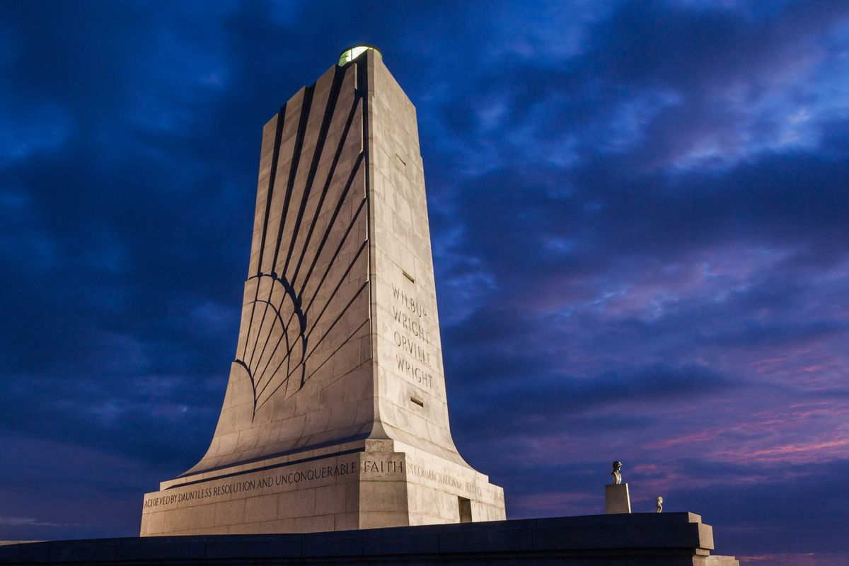 Slide 36 of 51: Wright Brothers National MemorialThe Wright-Patterson Air Force Base located in Dayton, Ohio, is where Wilbur and Orville Wright worked on their aircraft and learned how to fly. The memorial, which was first built in 1940, is a sight to be seen (and lit at night beautifully) and can be found on Wright Brothers Hill.