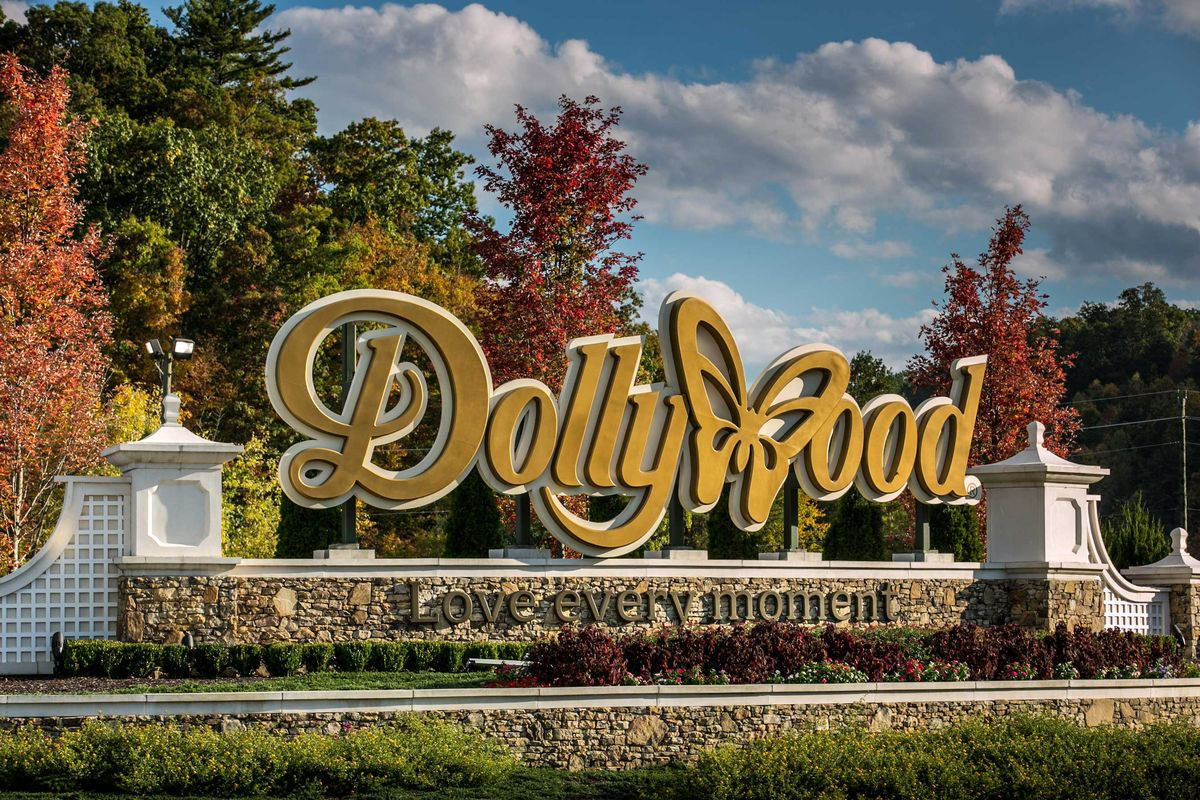 Slide 43 of 51: DollywoodJointly owned by Dolly Parton and Herschend Family Entertainment, Dollywood is located in the Knoxville Smoky Mountains metroplex in Pigeon Forge, Tennessee. Don't be fooled by the butterfly in the logo—their wooden roller coaster Lightning Rod reaches a top speed of 73 mph—the fastest for a wooden roller coaster in the world!