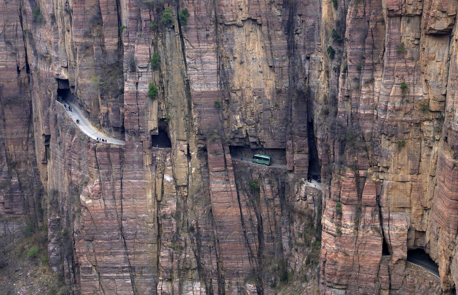 """Slide 42 of 44: It might be less than a mile but driving along the terrifying Guoliang Tunnel will feel like one of the longest drives in your life. The rocky tunnel was carved into China's Taihang Mountains by 13 villagers in the 1970s who wanted a link to the rest of the Huixian, Xinxiang, Henan Province of China. Previously there had only been steep, narrow and dangerous stairs from Guoliang. Uneven and twisty, the tunnel has various """"windows"""" where you can peer down the mountain...if you dare. Talk about dramatic!"""