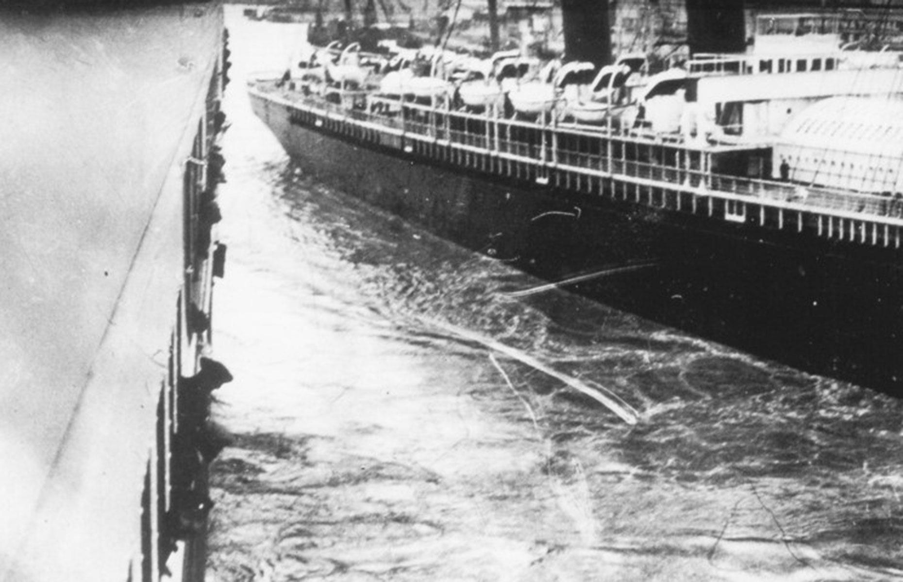 Slide 6 of 46: But even the Titanic's departure wasn't without drama. As she pulled away from the dock at Southampton she almost crashed into another ship. The New York (pictured right) was moored nearby and, as the Titanic was leaving, the massive ropes that held the smaller ship snapped. Only quick thinking from the Titanic's crew, who used a wash of water from a propeller to push the other ship away, avoided a collision. It was an ominous start to the voyage.