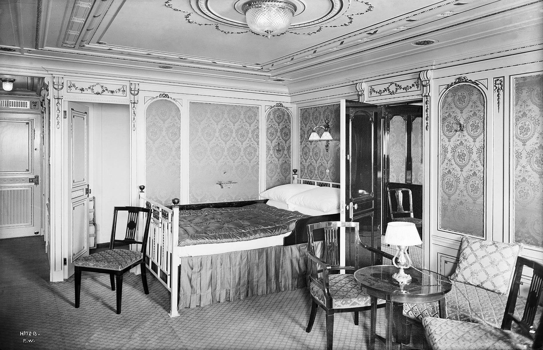 Slide 18 of 46: Two of the parlor suites were occupied by J Bruce Ismay, the chairman of the White Star Line (more about him later). The suite pictured here, B-58, was taken by the Baxter family, from Montréal, Canada, who boarded at Cherbourg. Mrs Baxter was a widow and traveling with her daughter Mary Hélène and son Quigg, who went down with the ship.