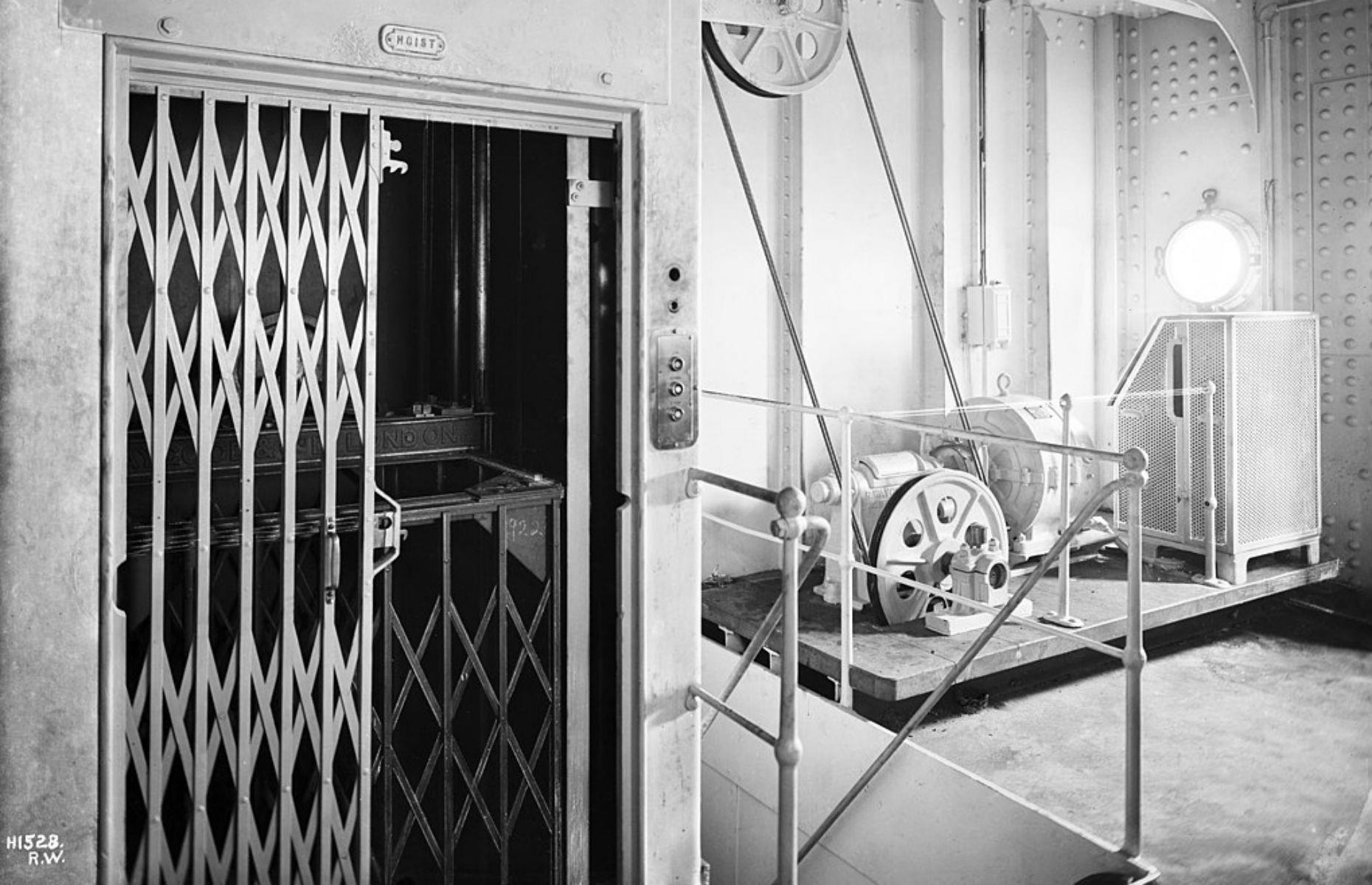 Slide 24 of 46: Like in first class, second-class passengers had access to elevators which would have been like this one from the RMS Olympic. Although not as extravagant as those in first class where there were sofas to recline on, they still saved passengers the effort of having to climb the stairs between decks.
