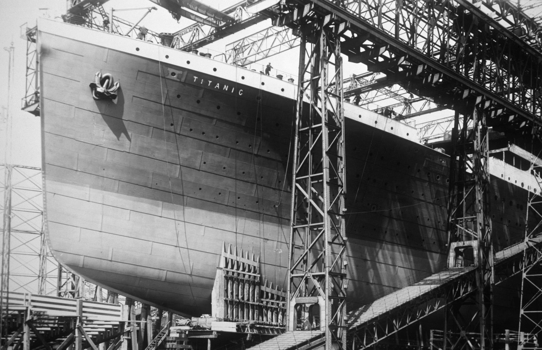Slide 3 of 46: It took four years from 1909 to build the Titanic at the Harland & Wolff shipyard in Belfast, Northern Ireland. Costs were lavish at the time – around$7.4 million (£1.5m)in total, around$192 million (£147m)in today's money. Thanks to 16 watertight compartments (known as bulkheads)that could be shut to prevent flooding, the Titanic was designed from the offto be unsinkable and considered one of the safest ships afloat.