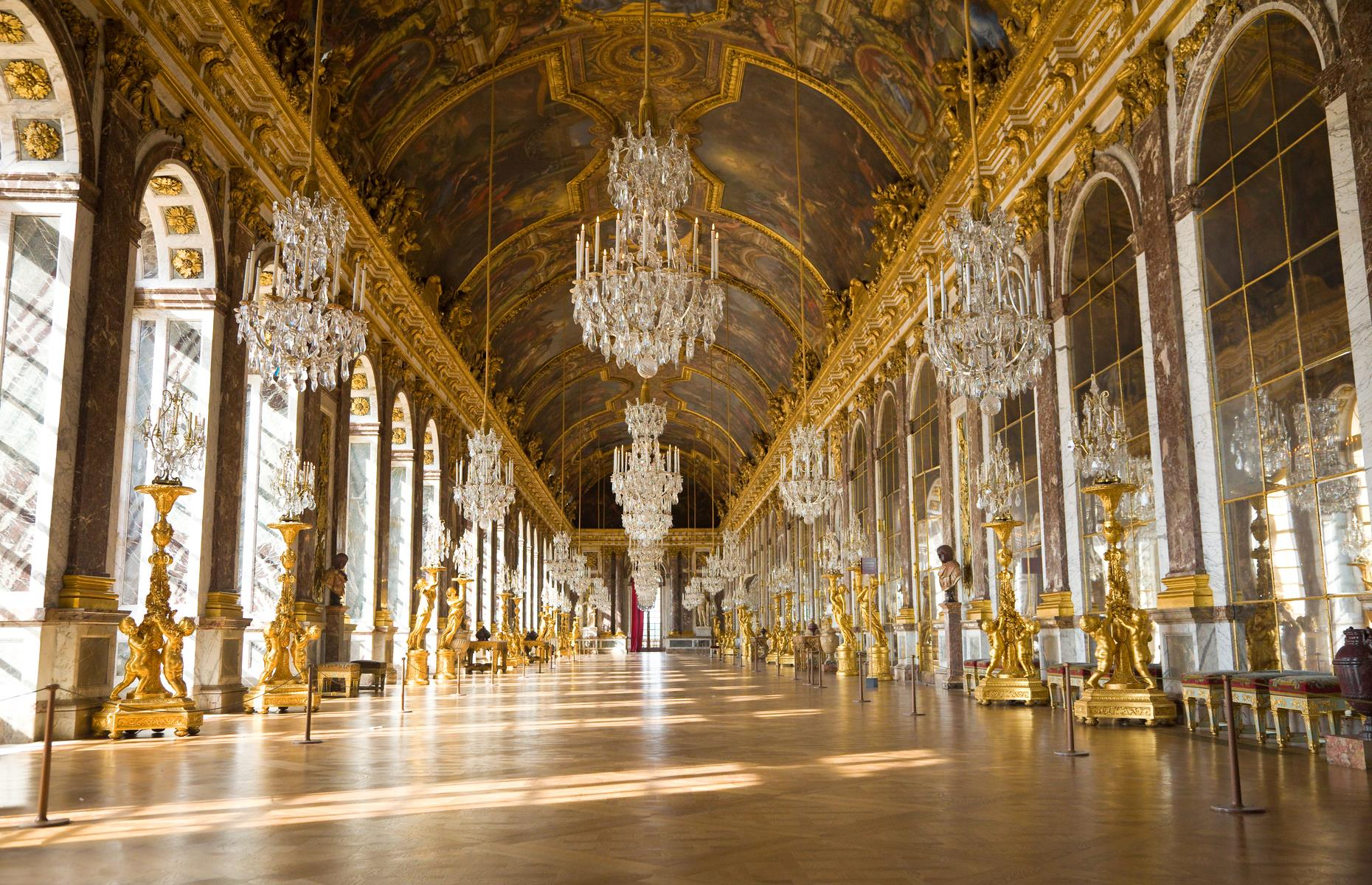 Slide 13 of 53: The interior is so dazzlingly beautiful it's hard to know where to look. Literally so in the Hall of Mirrors, a central gallery that sparkles with chandeliers and is home to around 5,000 pieces of antique furniture and 6,000 priceless paintings.