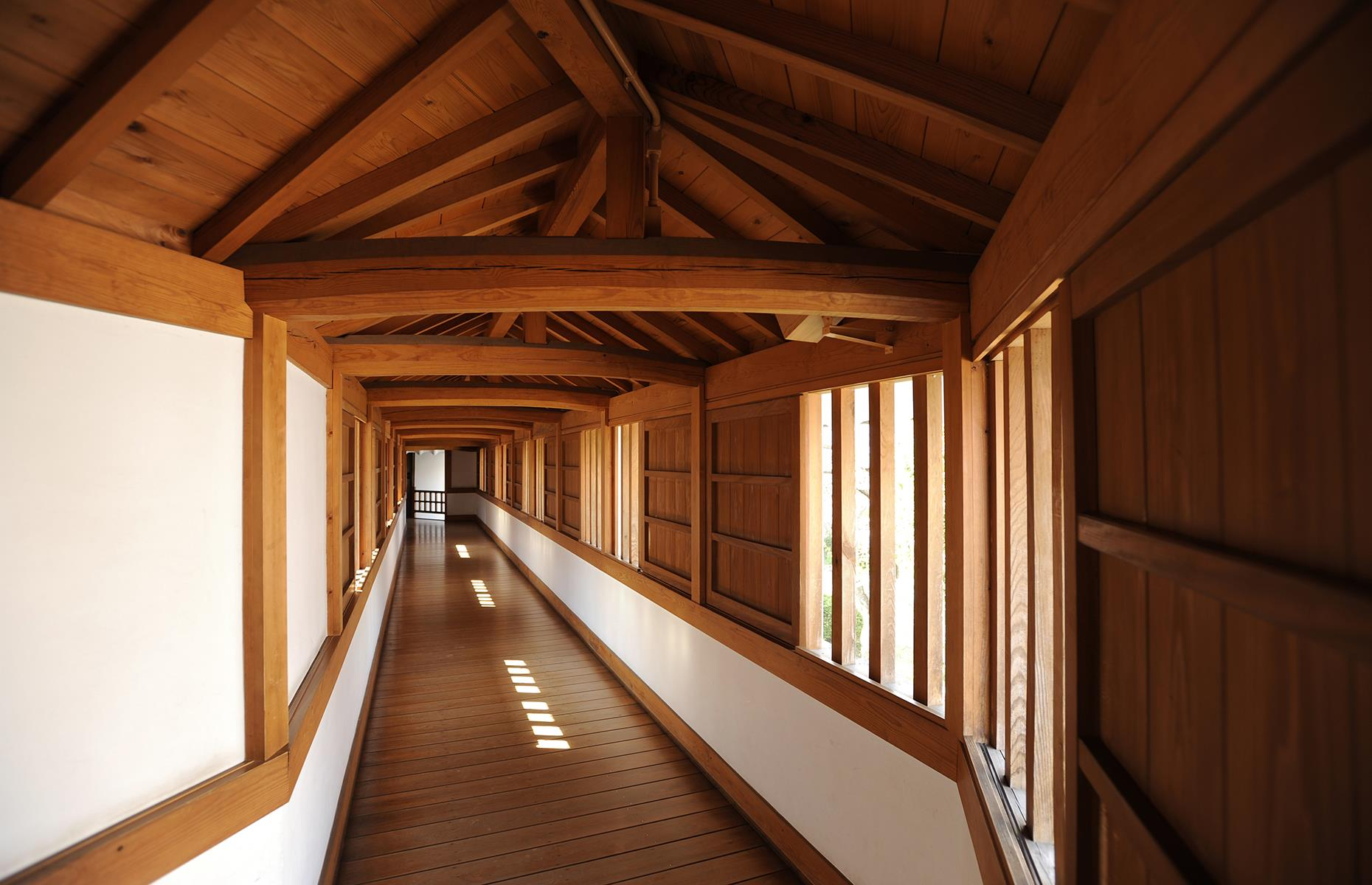 Slide 48 of 53: Himeji also miraculously escaped damage during bombing in the Second World War and the Great Hanshin earthquake in 1995. Inside the castle's interior is plain with little decoration, however, looks can be deceptive. Many of the castle's walkways turn back on themselves to confuse invaders and even today's visitors can end up bamboozled.