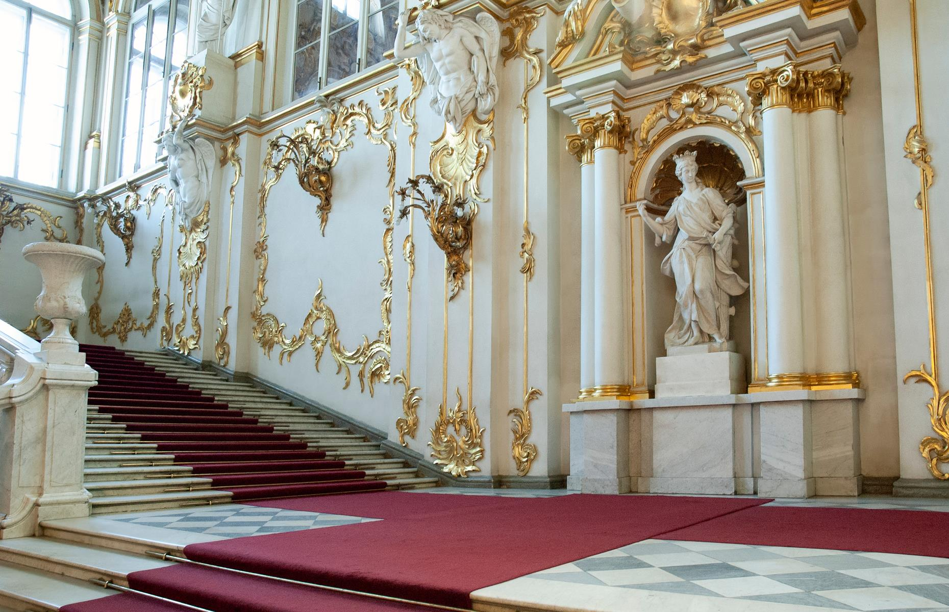 Slide 9 of 53: The palace has 1,945 windows and 1,786 doors, and overflows with columns, artworks and statues, such as those that adorn the Jordan Staircase. It was the official residence of Russian Emperors until 1917, and no building in the city is allowed to overshadow it.