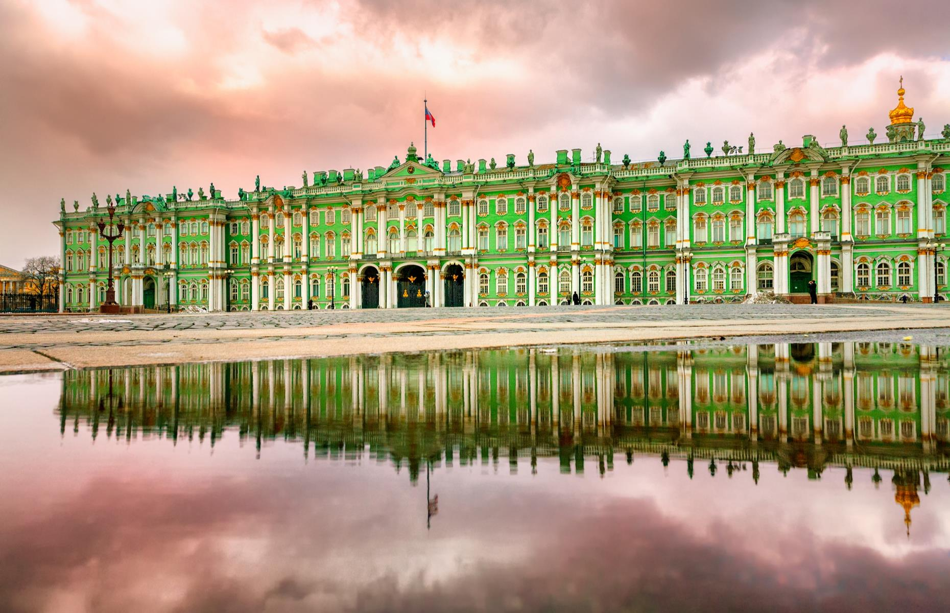 Slide 7 of 53: This Baroque-style masterpiece is St Petersburg's most famous landmark, and among the world's most lavishly lovely palaces. The mint, gold and ivory exterior looks like it's popped straight out of a Wes Anderson movie, or perhaps fallen off a particularly extravagant wedding cake.