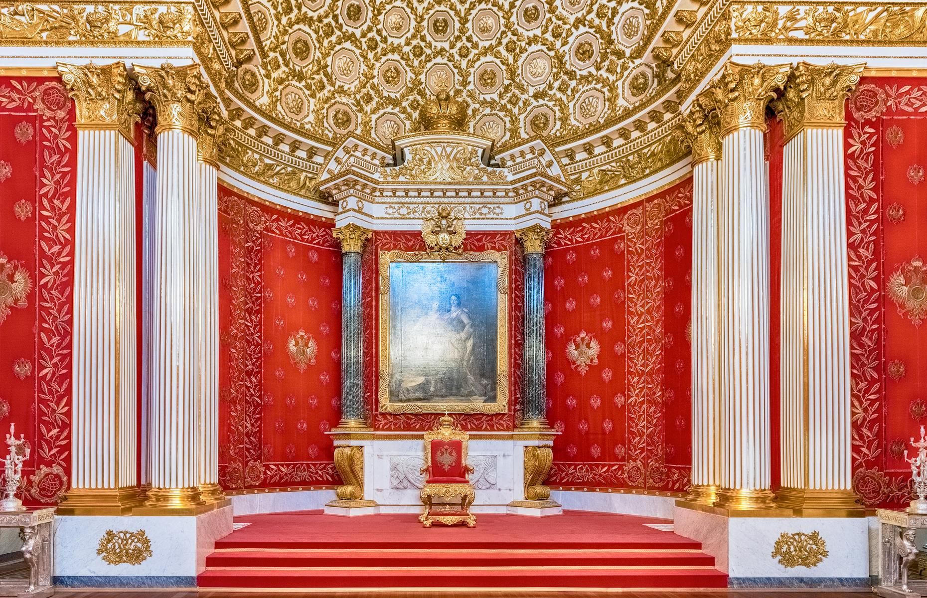 Slide 8 of 53: The inside is equally opulent, which is a big ask given the gilded promise of the exterior. The interior has a staggering 1,057 rooms, including the bold red Small Throne Hall (where 'small' is used as a relative term), plush with velvet and gold detailing.