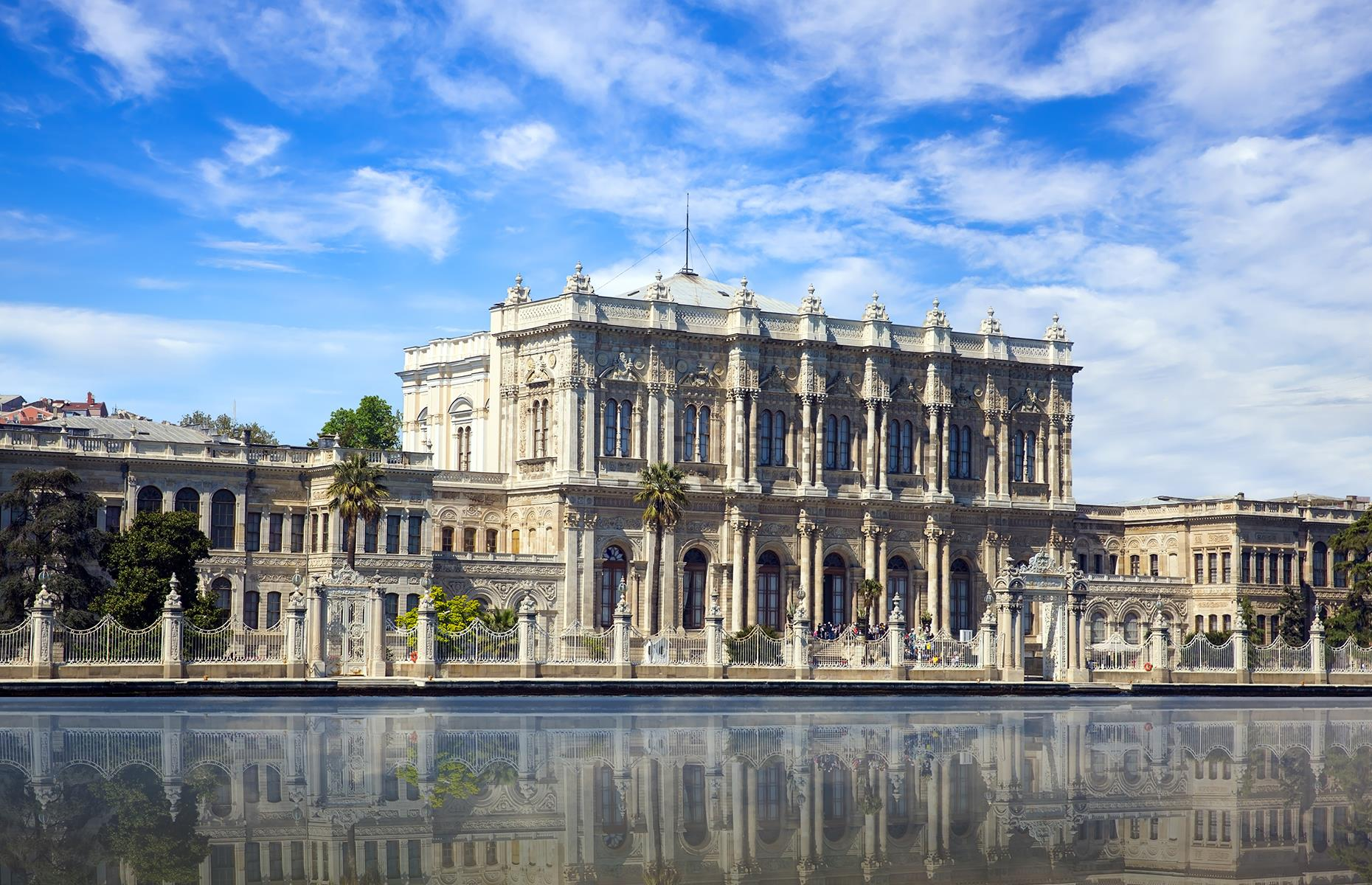 Slide 40 of 53: Home to 285 rooms, 46 halls and 68 bathrooms, it's safe to say that Turkey's Dolmabahçe Palace is one of the world's most opulent palaces. The estate served as the seat of Ottoman Empire from 1856 to 1887, and 1909 to 1922, and its spectacular interior conceals a rather lavish secret. During the construction, Emperor Abdülmecid I wanted no expense to be spared, so a whopping 14 tons of gold were used to gild the palace's ceilings.