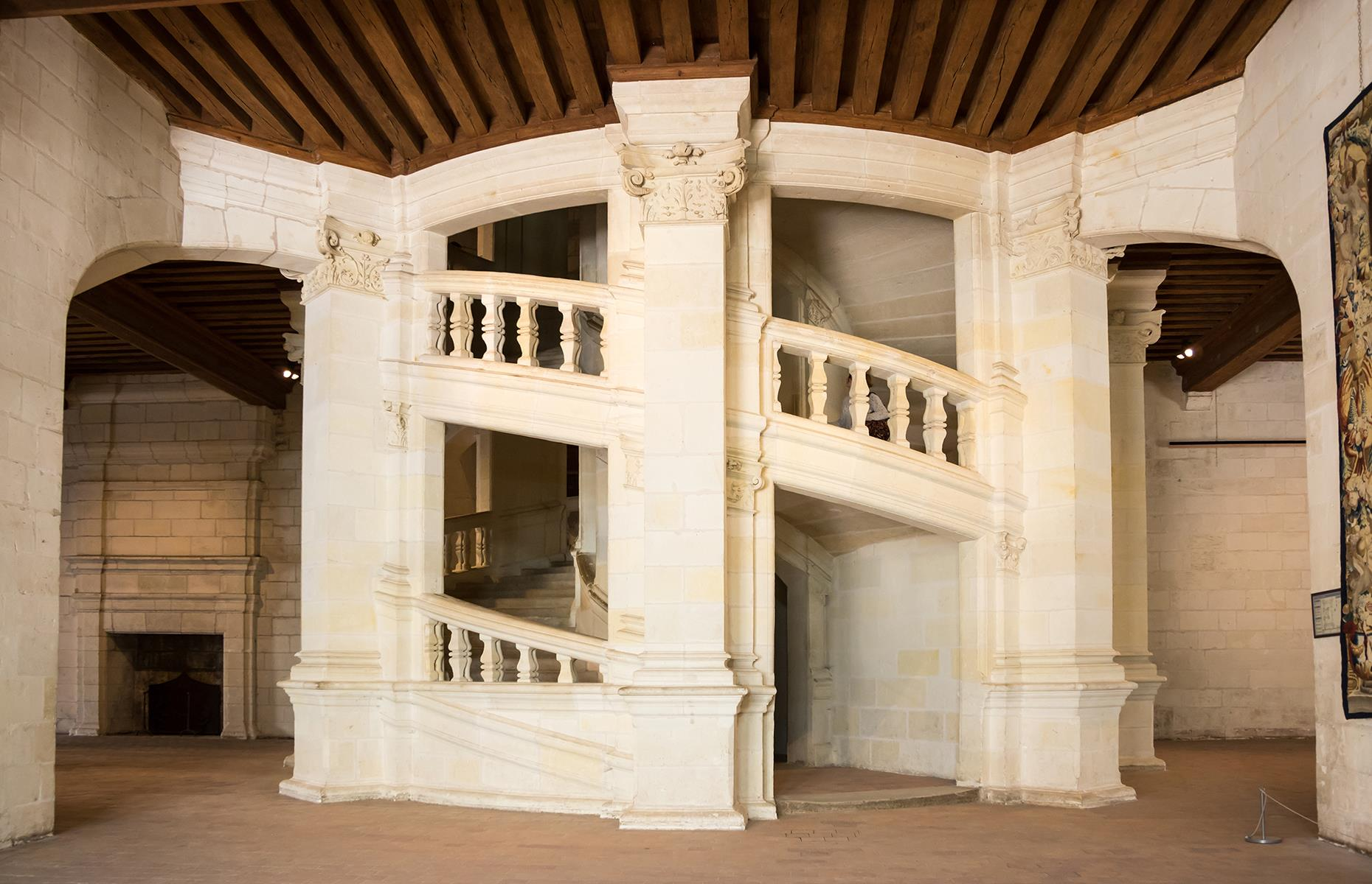 """Slide 44 of 53: Although the château's interior is as grand as the outside it's the famous double staircase that's most alluring. The """"double helix"""" serves all the château's many floors and is designed so that if two people are using each staircase, they can see each other through the windows yet never cross paths."""
