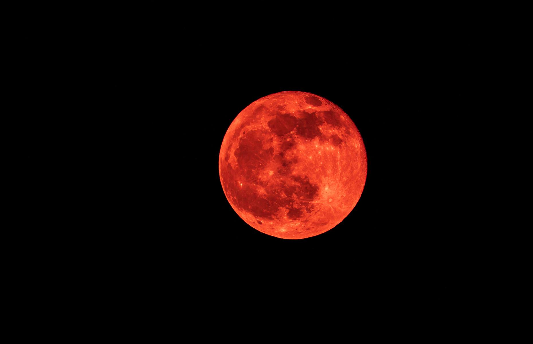 Slide 19 of 41: Also known as a blood moon, this blazing display happens during a total lunar eclipse. Although surrounded by many superstitions and prophecies, the red hue is actually due to the red edge of the Earth's shadow, which is reflected on the moon. It can be seen around the world, although it's at its best in Alaska, the Hawaiian Islands and the west of the USA.