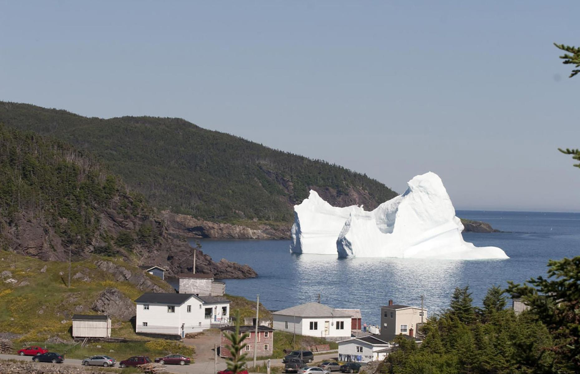 Slide 26 of 41: The so-called Iceberg Alley off the coast of Newfoundland is no stranger to massive icebergs and every year in spring all shapes and sizes of these frozen giants slowly drift past. Funnily enough, this event coincides with the annual whale migration in the opposite direction making for quite the spectacle.