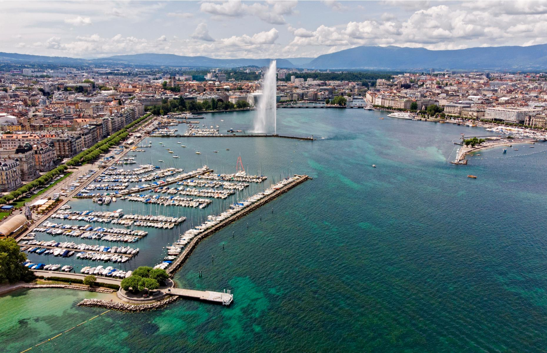 Slide 20 of 31: One of Geneva Harbour's most recognizable features is the 460-feet tall (140m) Jet d'Eau water jet that springs out from the lake and pumps out 500 liters (132 gallons) of water per second. Seen from above, the harbor filled with yachts and surrounded by stunning mountains is a sight to behold. Take a look at the world's most incredible photos from above.