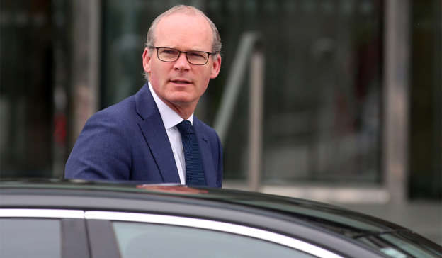 Simon Coveney wearing a suit and tie: Foreign Affairs Minister Simon Coveney has denied that he was involved in helping the 'Dubai Two' to fly home. Pic: Sam Boal/RollingNews.ie