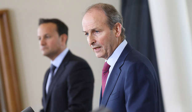 Micheal Martin wearing a suit and tie: Extra.ie has learned that the Restaurant Association of Ireland (RAI) is considering taking a new legal action against the Government. Pic: Julien Behal/PA Wire