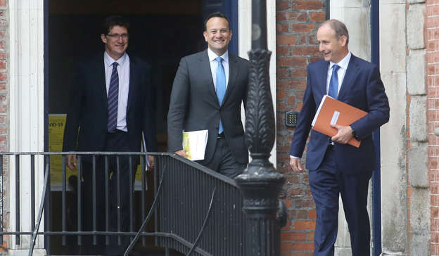Eamon Ryan, Leo Varadkar, Micheal Martin are posing for a picture: It comes after Tánaiste Leo Varadkar is understood to have questioned the Taoiseach Micheál Martin at a Cabinet meeting back in May about what 'making housing a number one priority' meant. Pic: Sam Boal/RollingNews.ie