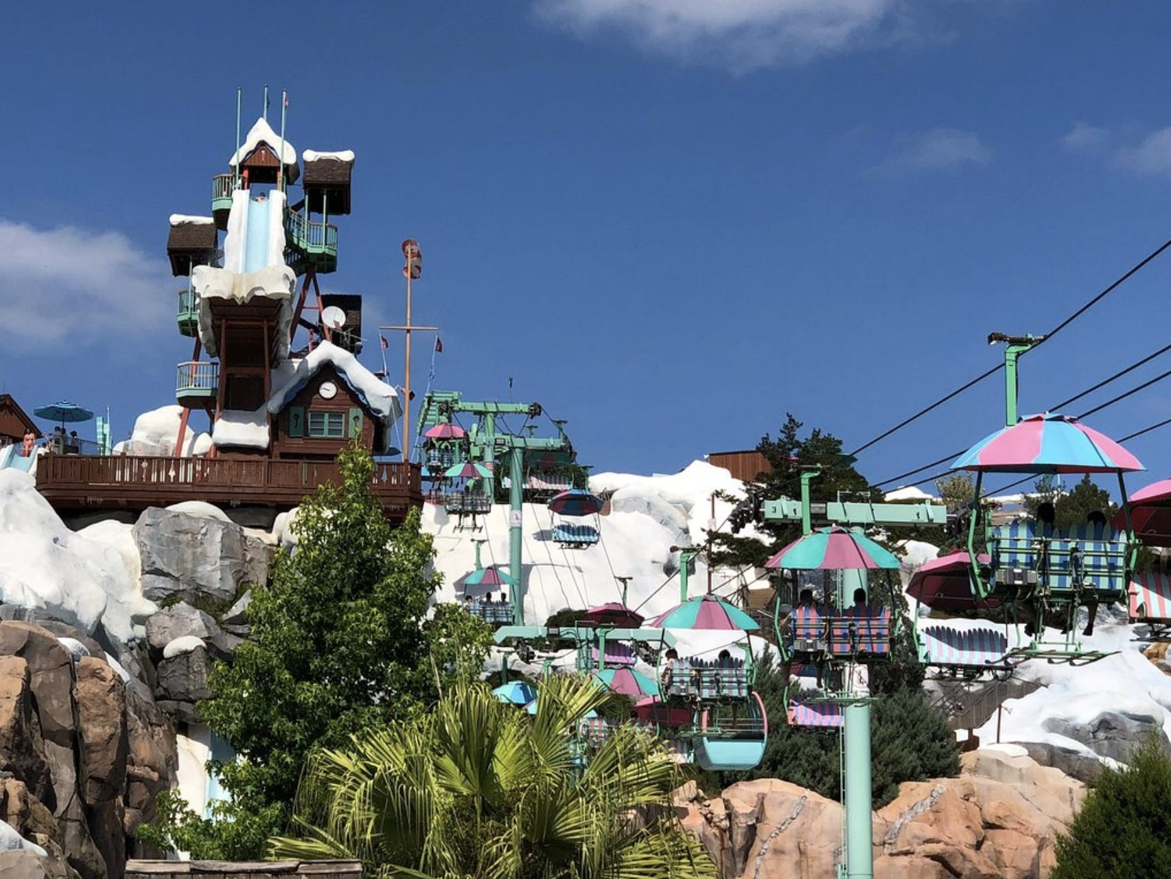 """Slide 7 of 17: Going along with Blizzard Beach's theme, the water park has a working chairlift with beach umbrella canopies that guests can ride up the """"mountain.""""The lift travels to the top of Mount Gushmore, where they can get in line for three of the park's top-tier attractions."""