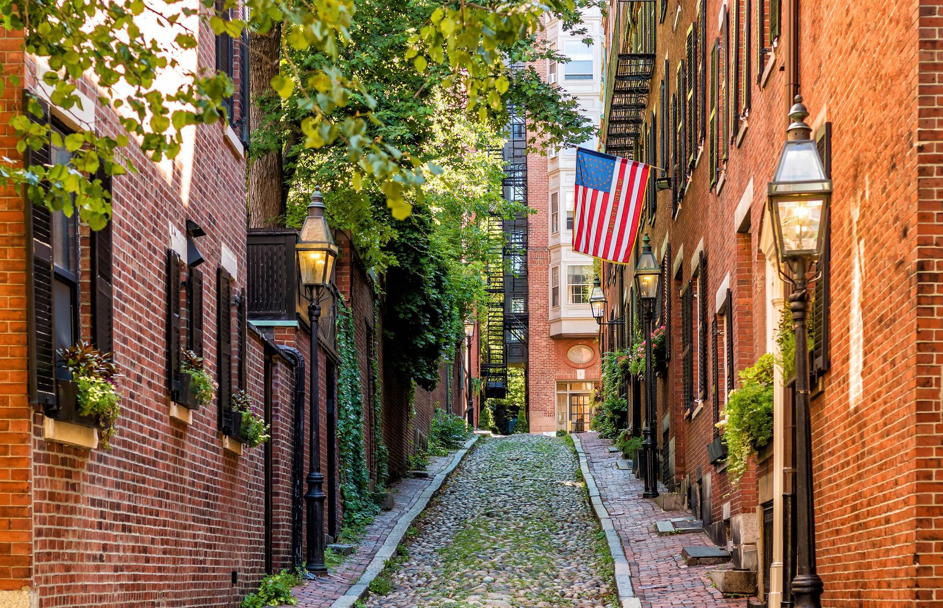 Slide 11 of 41: The city has some characterful old neighborhoods too: Beacon Hill was home to the first descendants of the early English settlers known as the Boston Brahmin. The picturesque area, with its red-brick row houses and gas-lit narrow streets, remains an elite enclave and is well worth a wander. As is the historic harbor, setting for the infamous Boston Tea Party. The informative and interactive Boston Tea Party Ships & Museum (now open) brings to life the story of the protest that helped start the American Revolution.