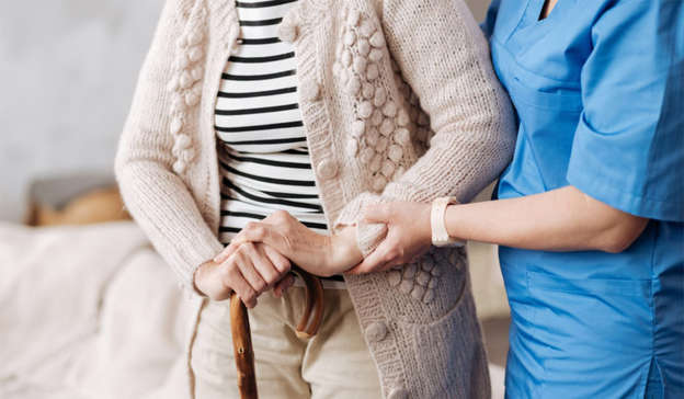 a person wearing a blue dress: Residents of St Joseph's nursing home in Ennis, Co. Clare, told inspectors that they were not allowed to have showers as a result of the coronavirus outbreak. Pic: Shutterstock